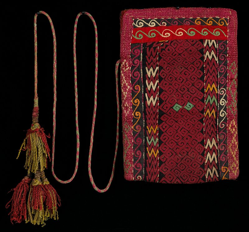 multicolors; embroidered with cross stitch; border uses several embroidery stitches and possibly some applied knit; stitched thorugh striped cotton lining; inside divided by cotton panel; narrow, braided strap; one tassel at bottom corner