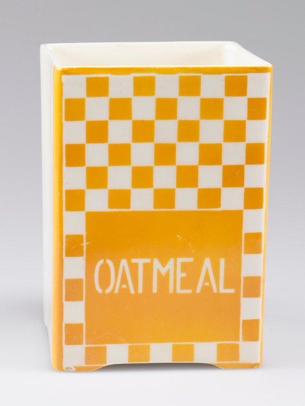 "open square container; porcelain with one side decorated with yellow-orange and white checkerboard and ""OATMEAL"" in white"