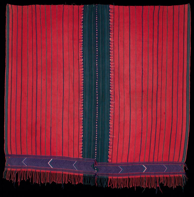 "two fine woven panels stitched together; red with narrow green and blue stripes; center is dark green striped; bottom edge has 2-2 1/2"" purple horizontal chevron border and self fringe"
