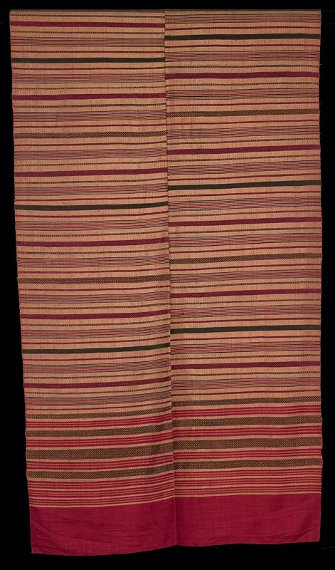 "silk; two panels, hand sewn together vertically; red with horizontal stripes of various widths, some stripes within stripes, some geometric designs in brown, gold and green; top and bottom hand hemmed; bottom 5 1/2"" solid red"