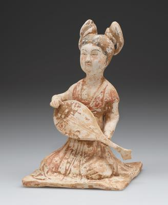 Seated figure of woman playing stringed instrument